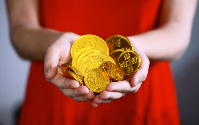 woman-holding-gold-coins